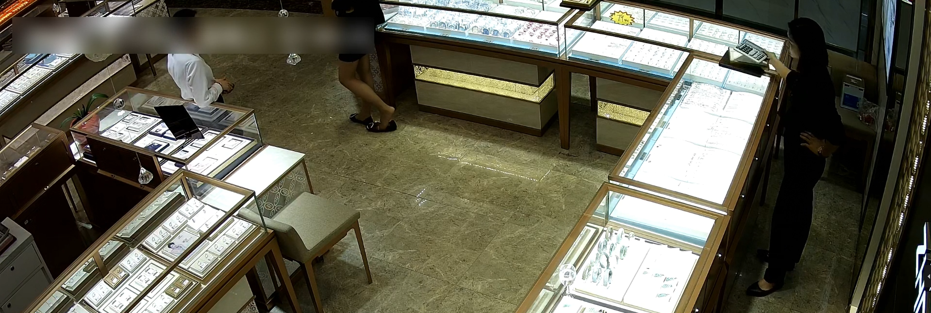 Jewelry Store Hostess In Flattie Dipping And Shoeplay